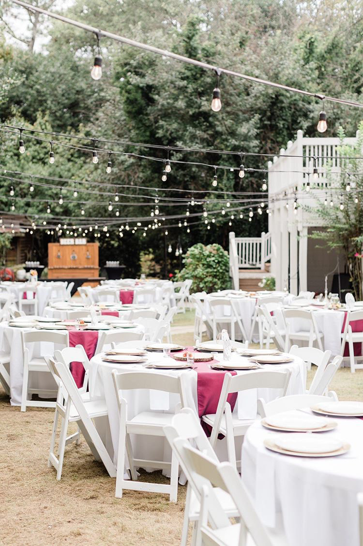 reception decor with wine colored runners and beer bar