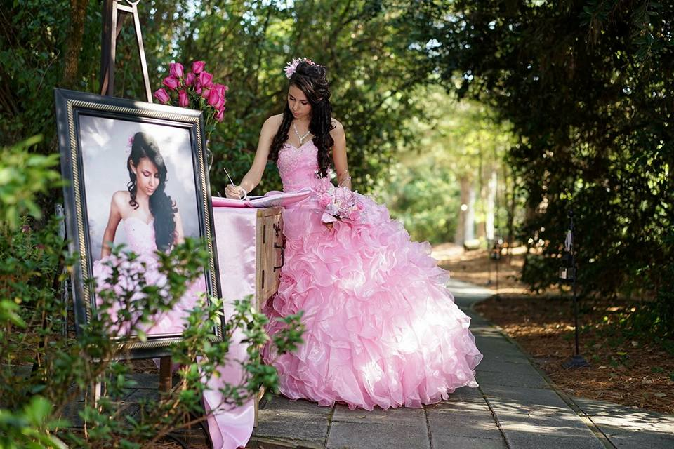 birthday girl in pink fluffy dress signing guestbook
