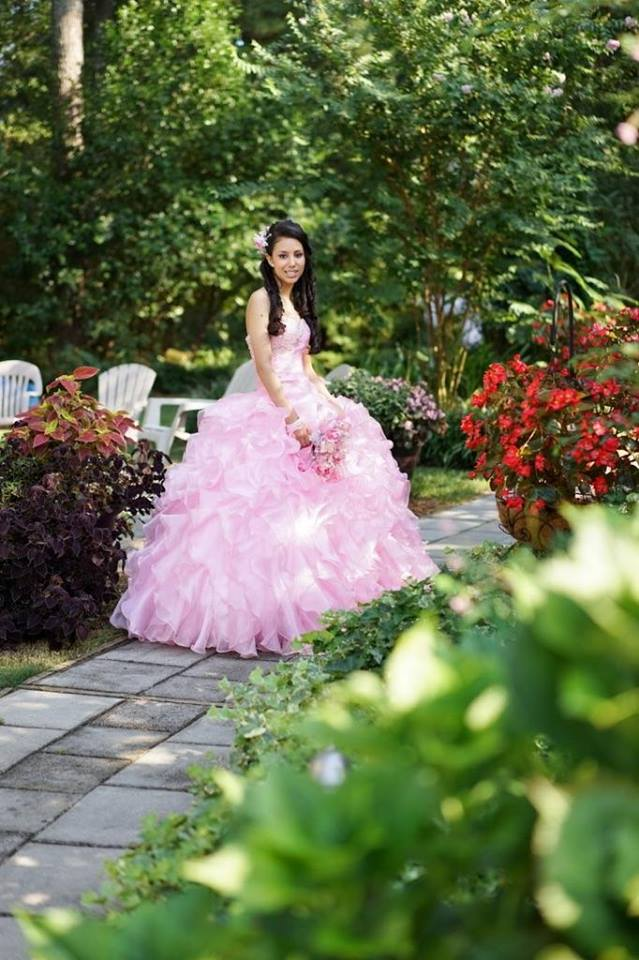 girl in light pink, ruffled dress for sweet 16