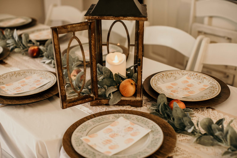 wood lantern with led candle, peaches, and lambs ear greenery