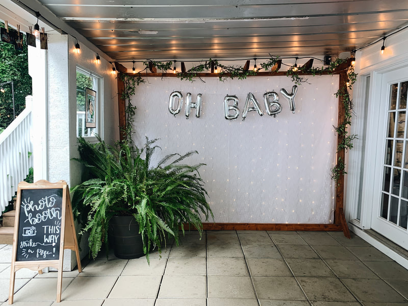 oh baby silver balloons with photo booth chalkboard sign