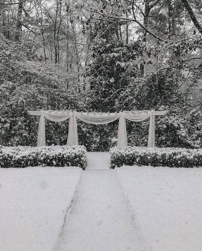 Four Oaks' outdoor wedding altar covered in snow