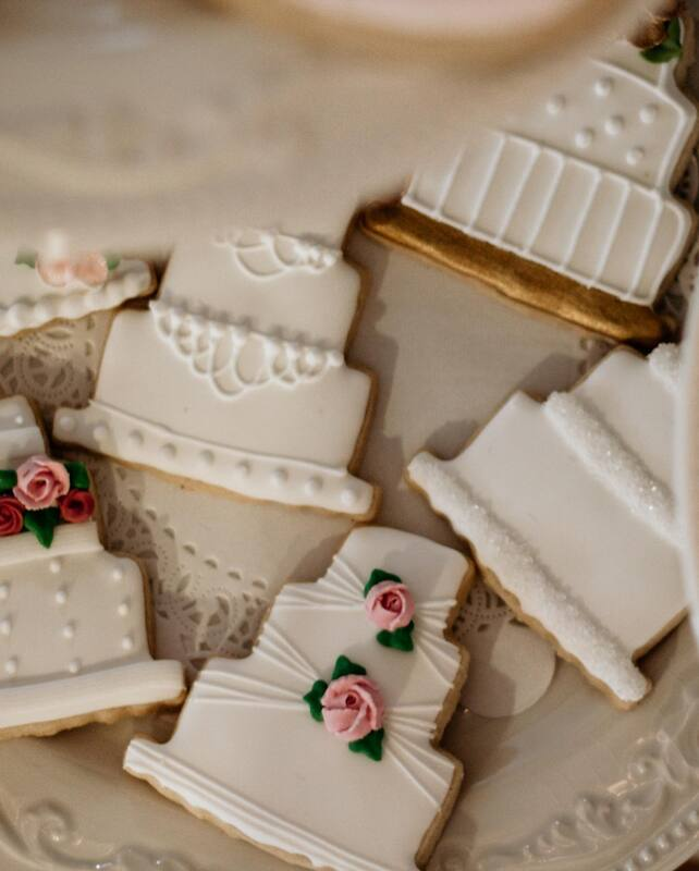 cookies decorated to look like 3-tiered wedding cakes