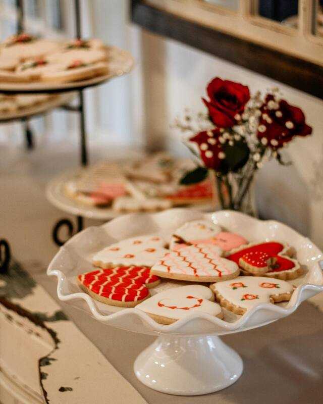 heart shaped cookies with red, white and pink designs