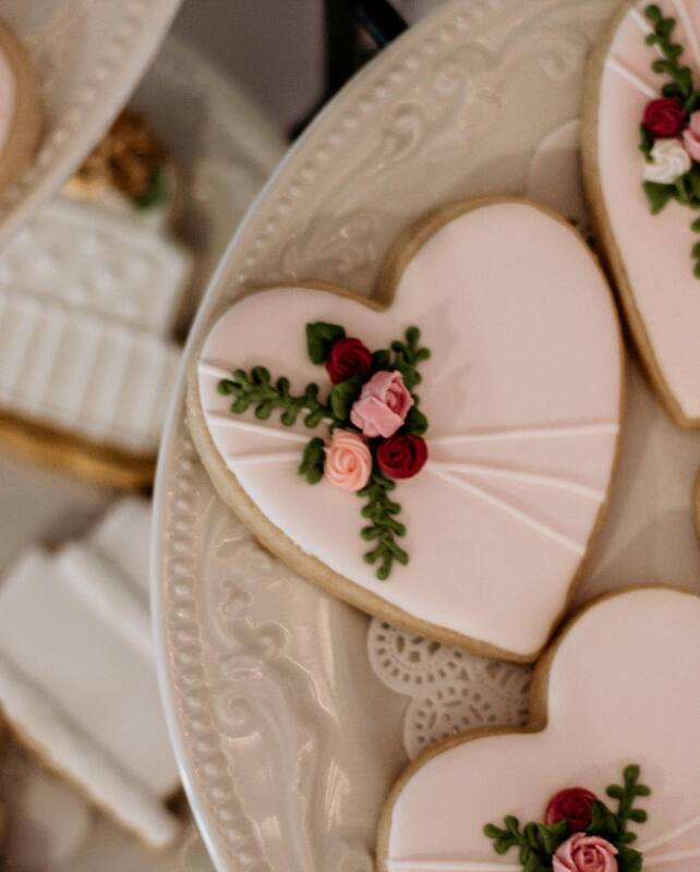 heart shaped cookies with floral design in icing