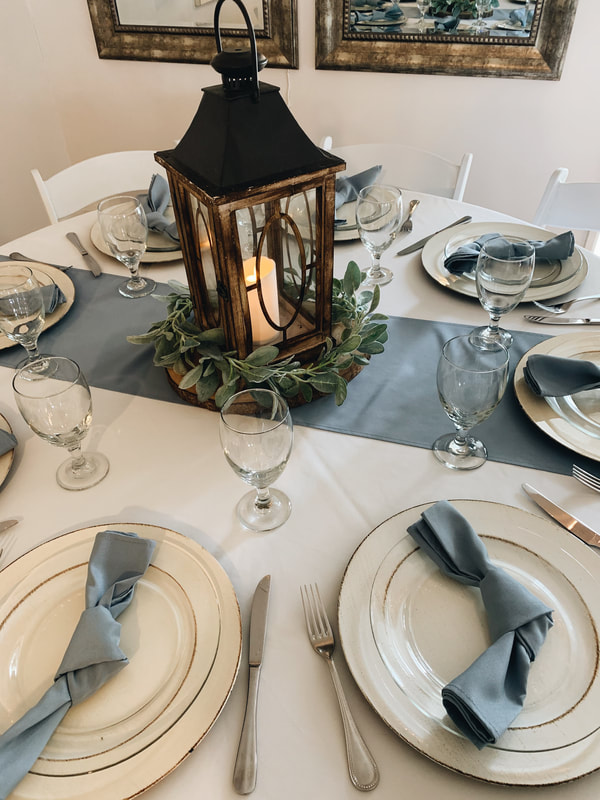 boy baby shower table decorations with dusty blue runners and napkins
