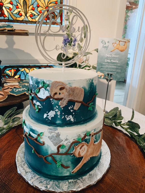 sloth decorated cake for boy baby shower