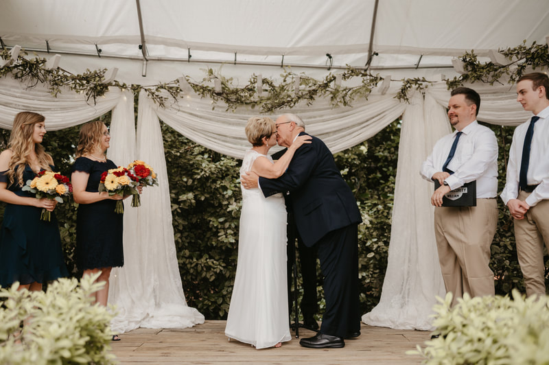 "older couple's first kiss after ""I do"""