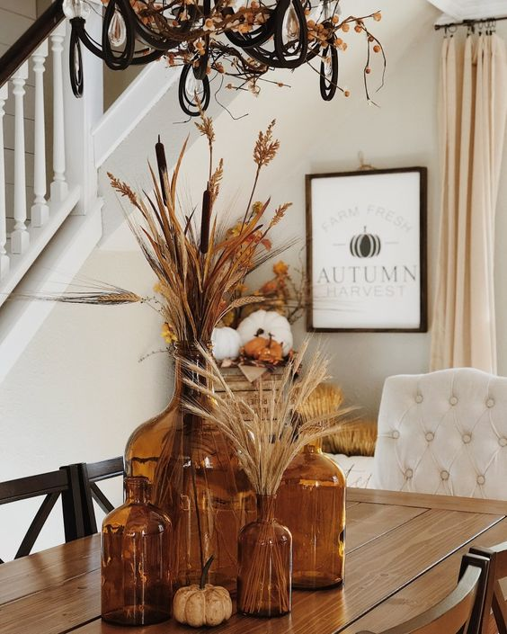 boho table centerpiece with amber glass jars filled with pampas grass