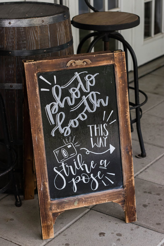 photo booth chalkboard sign wedding reception in fall