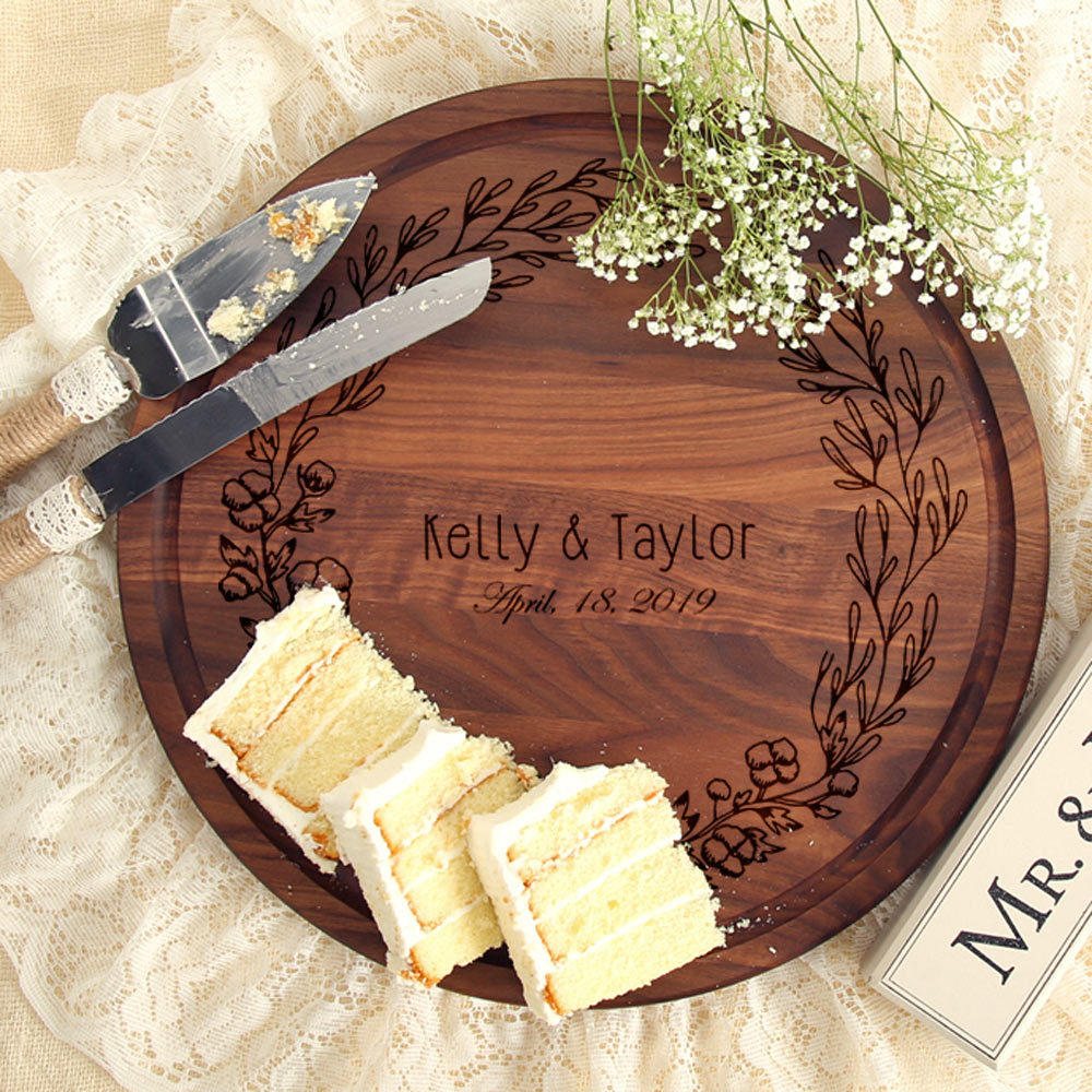 circular custom cutting board with wreath engraving and couple's name and wedding date