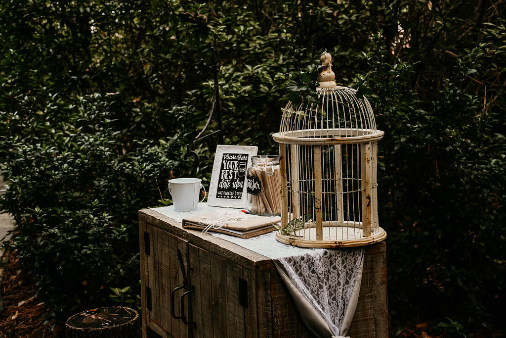 rustic guestbook setup with bird cage for cards, date idea unique guestbooks
