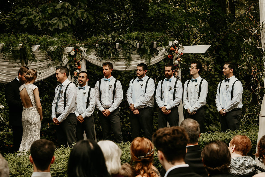 groomsmen lined up at outdoor wedding ceremony altar