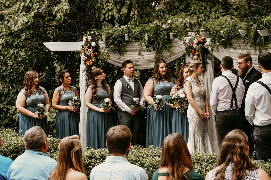 bridesmaids and bridesman lined up at altar during outdoor fall wedding ceremony