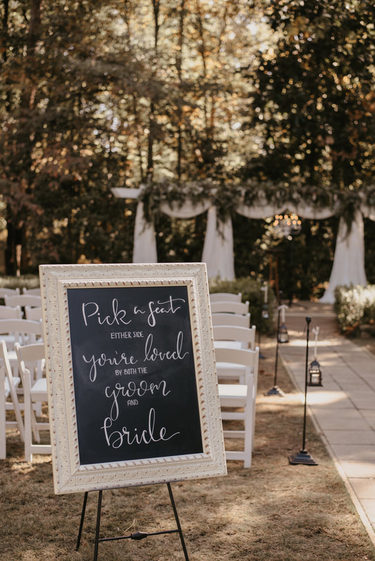 pick a seat chalkboard sign with white pane