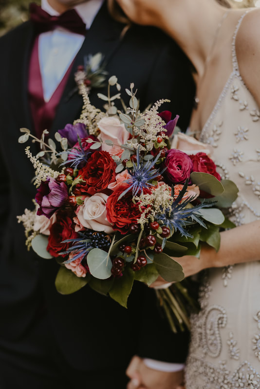 full bouquet with pink, red, purple, blush, and blue flowers