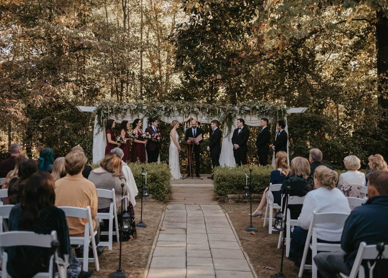 officiant speaking at outdoor November wedding