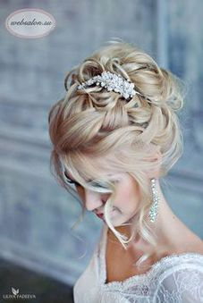 Summer wedding hairstyle up-do with elegant hairpin.
