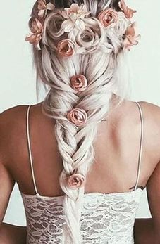 Braided summer hairstyle with flowers