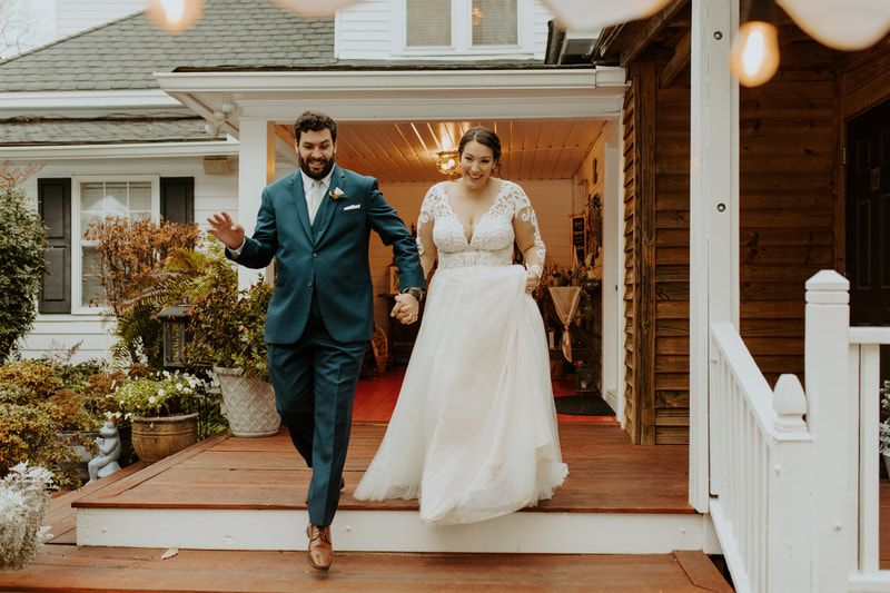 bride and groom walking down red porch steps during announcement
