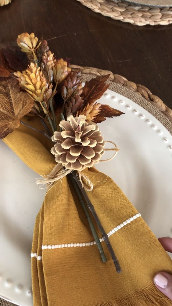 Fall place setting with mustard napkins, fall leaves, tied with acorn napkin ring