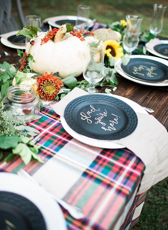 fun fall tablescape with plaid, pumpkins, fall florals, greenery, and neutral place settings