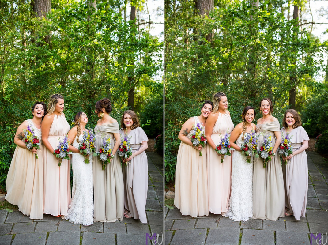 Bride posing with her bridesmaids holding spring bouquets