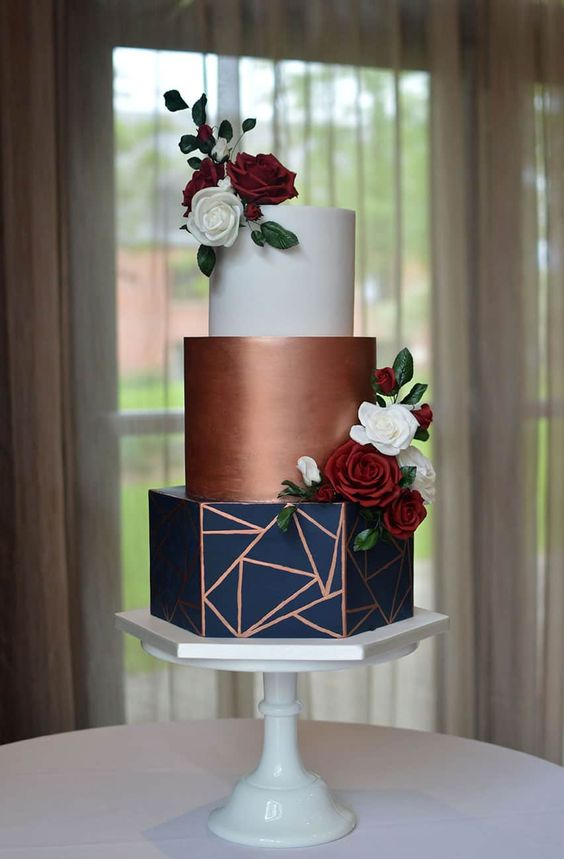 navy, copper, and white geometric wedding cake