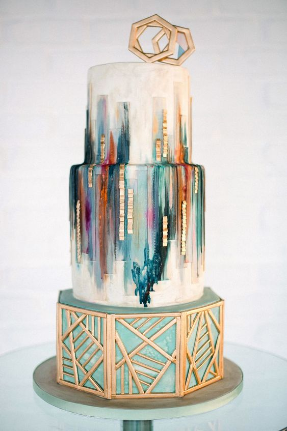 jewel toned wedding cake with gold and geometric shape details