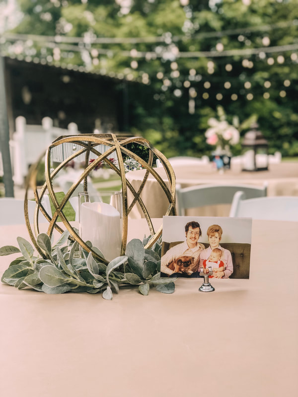 gold centerpieces with couple photos