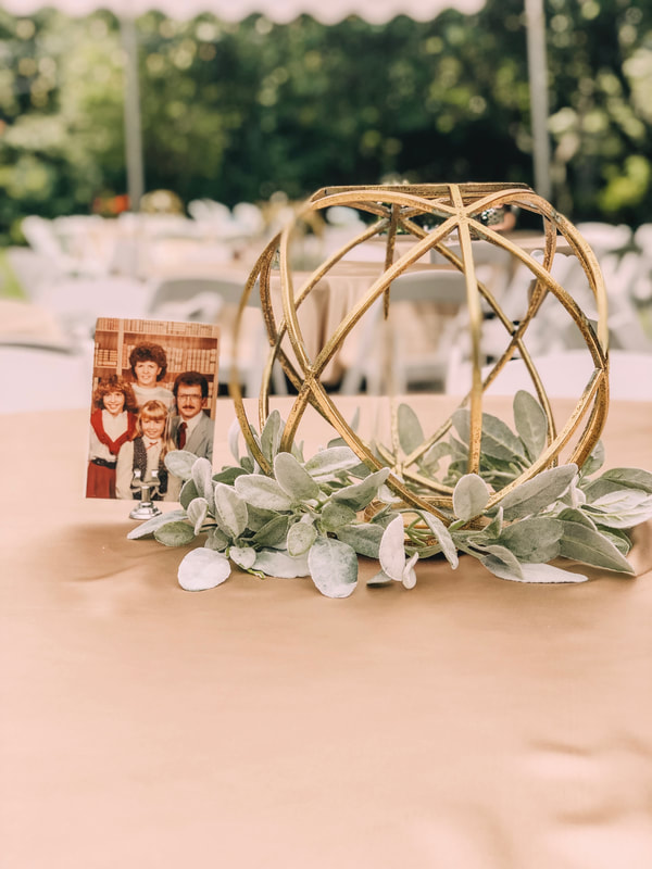 gold geometric centerpiece with family photos