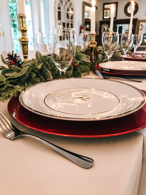shiny red chargers with snowflake china place setting