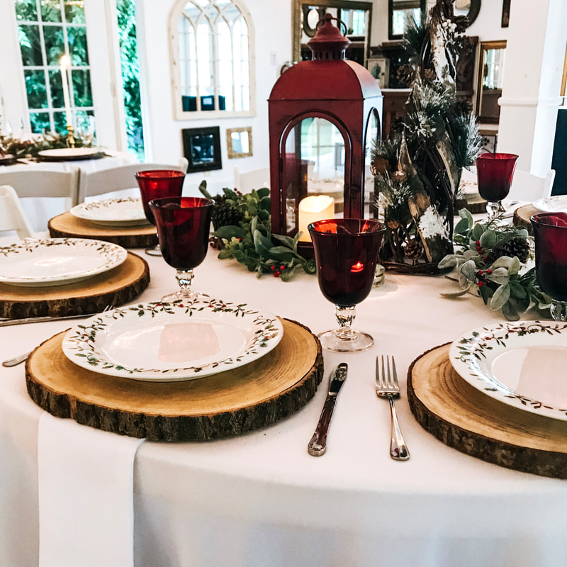 rustic holiday party table setup with red lantern