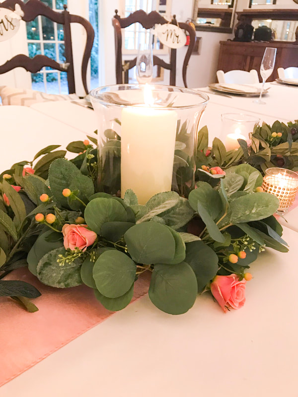 glass votives with greenery centerpiece