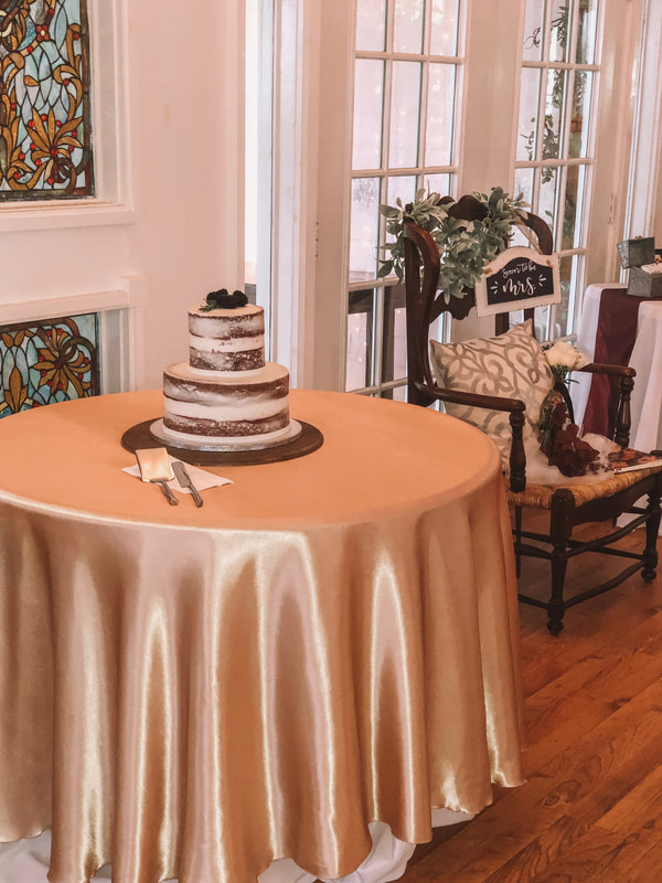 Rustic naked cake on champagne cake table bridal shower