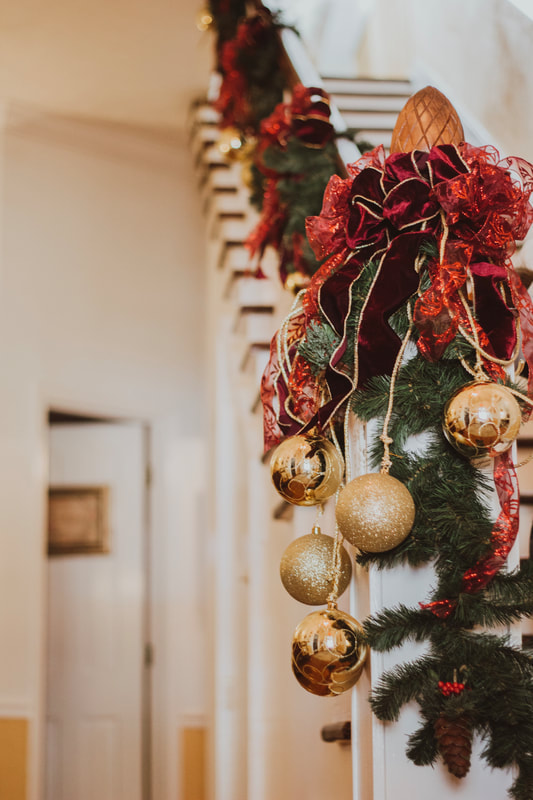 Christmas decorated stair rail in historic farmhouse