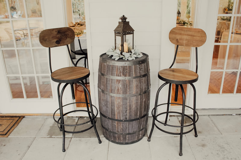 high top chairs with barrel table and centerpiece