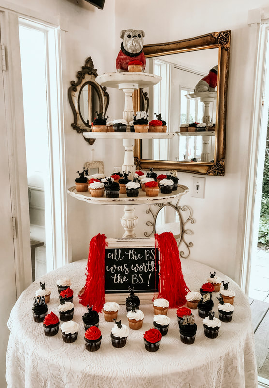 college graduation dessert bar with mini cupcakes