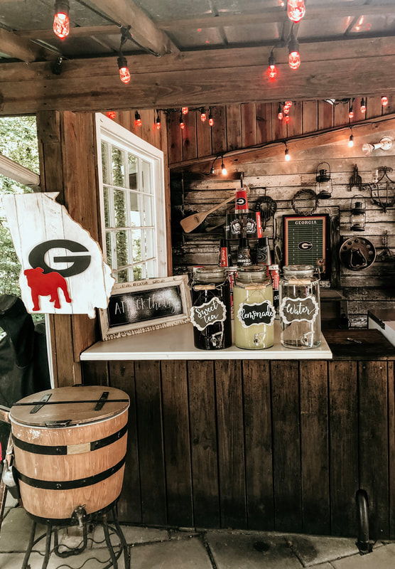 drink station setup at smokehouse with UGA decorations
