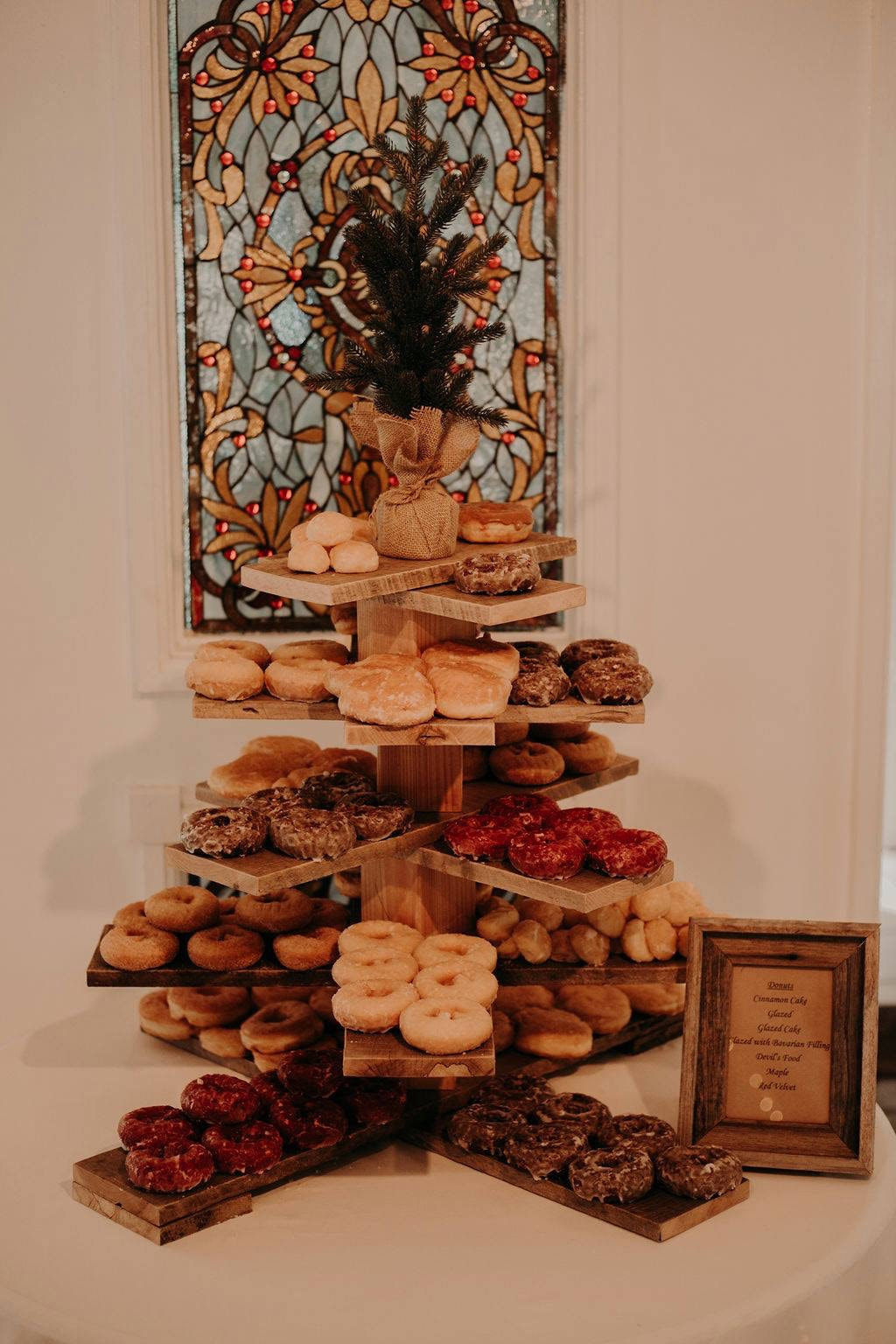 donuts on wood christmas tree for wedding dessert