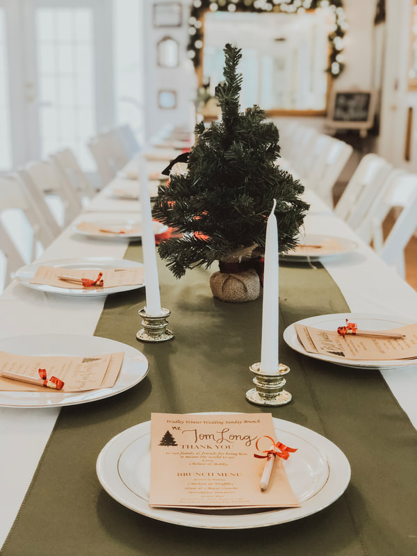simple holiday party table decor with green runners and candles