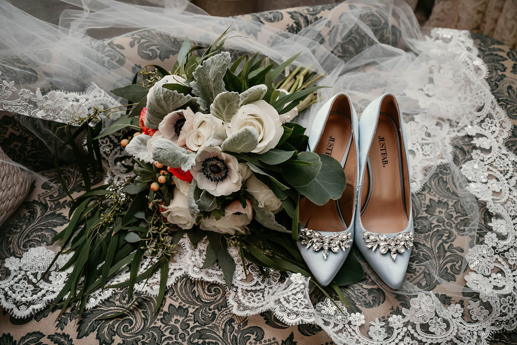 bride's vintage heels and veil with vintage-inspired bouquet