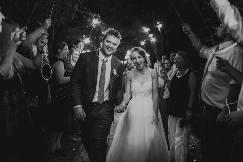 black and white photo of sparklers and glow sticks grand exit