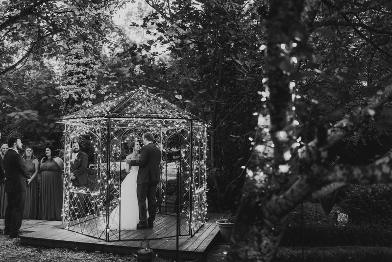 black and white photo of married couple's 1st dance in gazebo