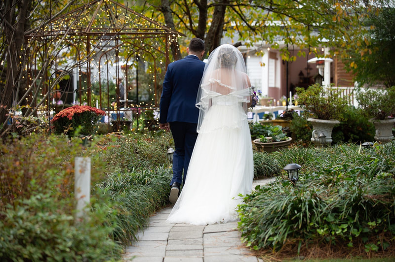 newlyweds exiting ceremony and walking down outdoor aisle together