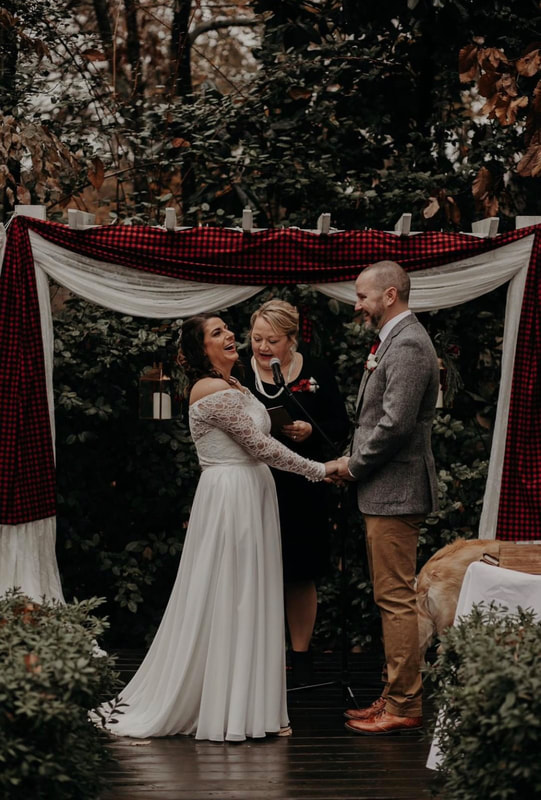 bride laughing at altar decorated with buffalo plaid fabric