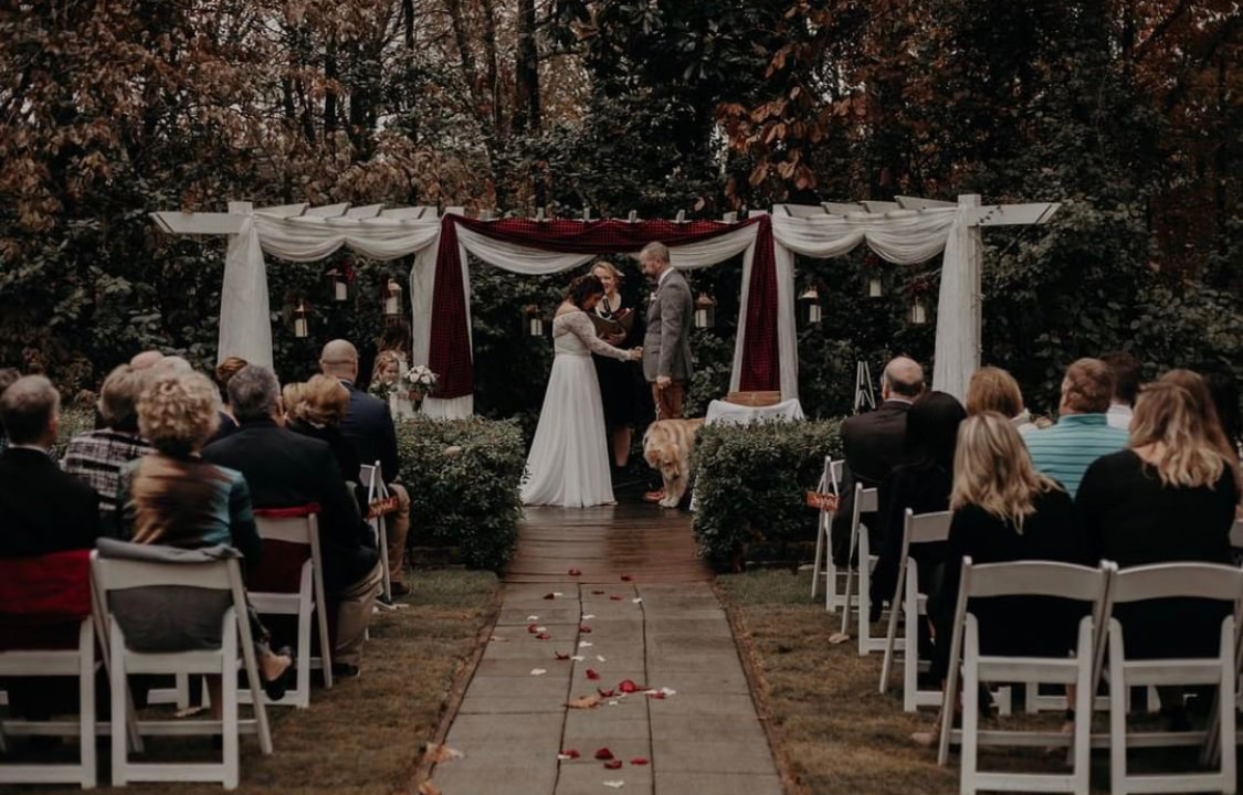 christmas themed altar at outdoor wedding ceremony