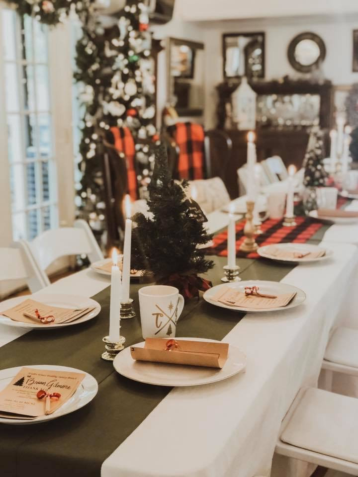 Christmas themed wedding tables with green runners and mini tree centerpieces with candlesticks