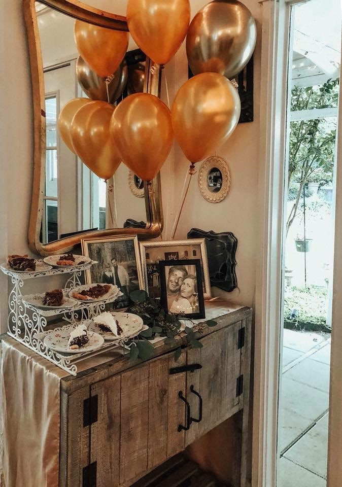 dessert table with couple photos and balloons