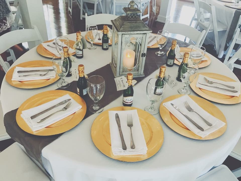 charcoal and gold table setup with mini champagnes